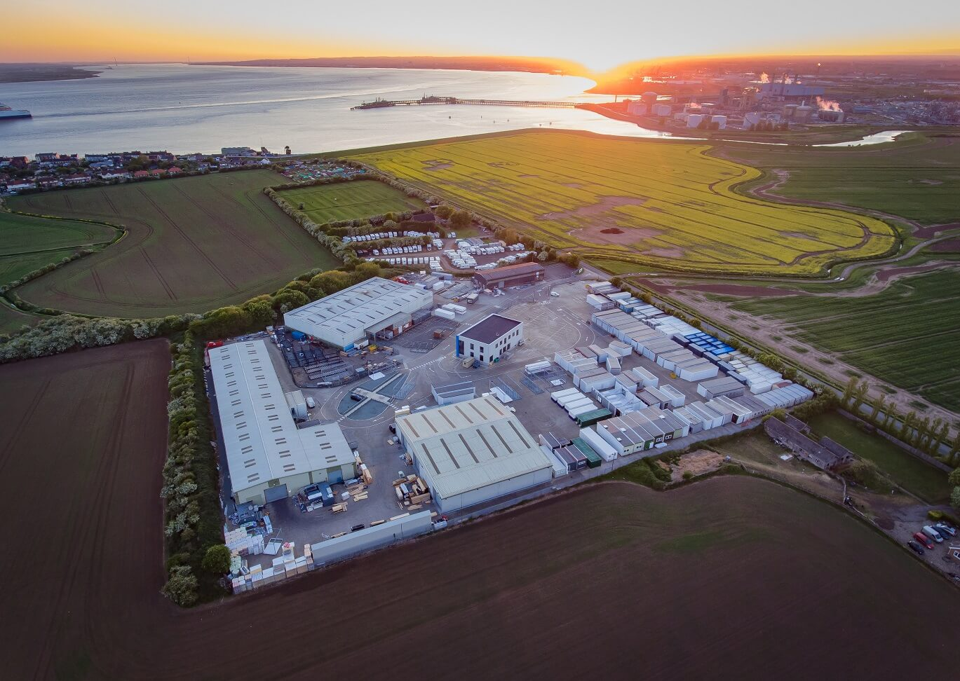 An aerial view of Integra Buildings' site at Paull, close to the Humber estuary, with the land earmarked for expansion in the foreground (Photo Craig Marriott)