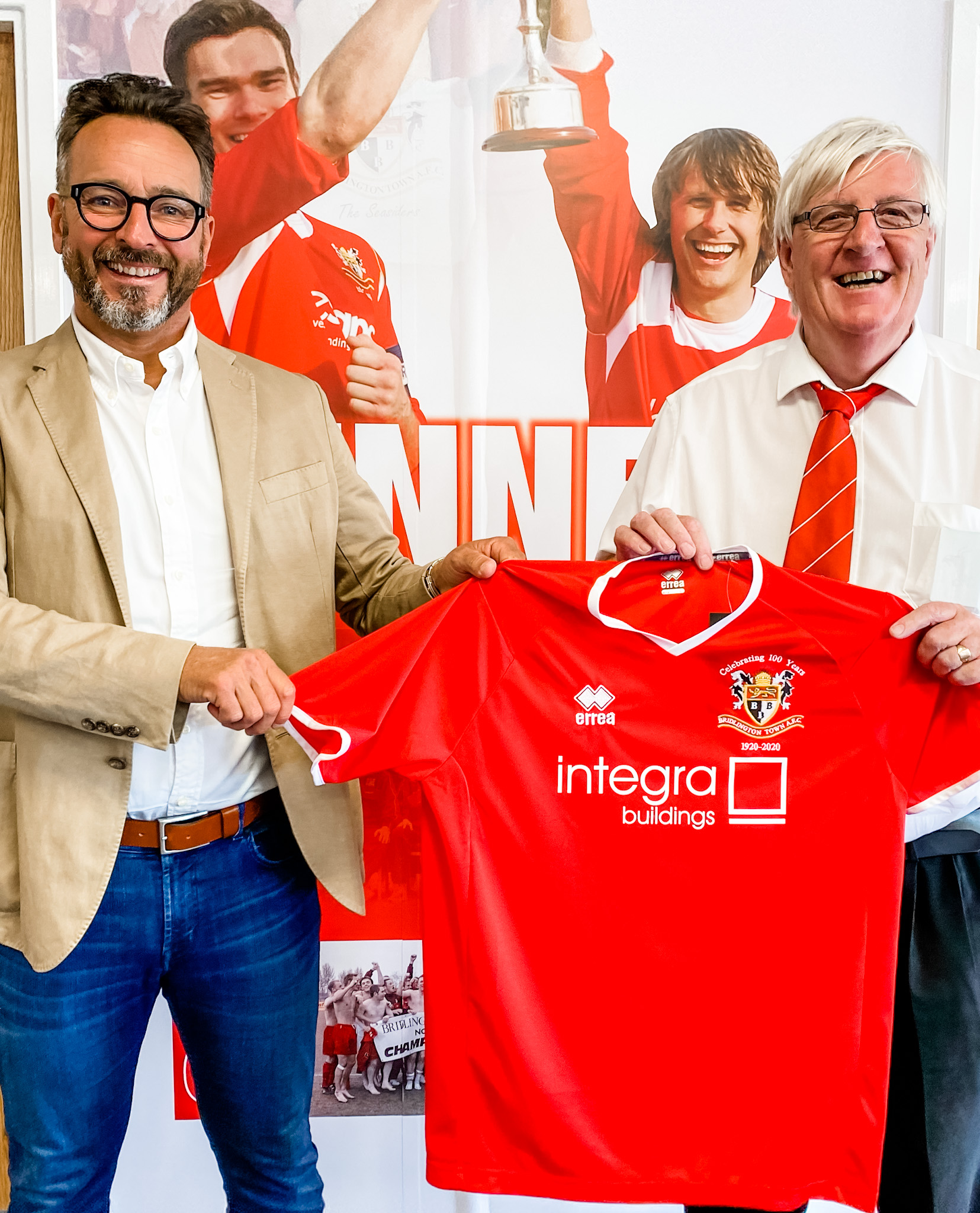 Integra Buildings Managing Director Gary Parker, left, and Bridlington Town Chairman Pete Smurthwaite celebrate the sponsorship deal by showing off the club's new shirt.