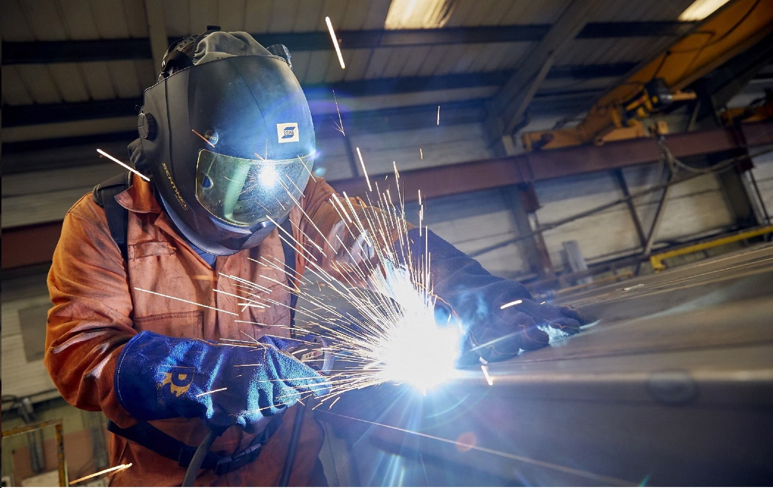 A welder at work in one of Integra Buildings' busy factory units. The fast-growing company has been chosen to be part of a four-year drive to deliver modular construction projects.