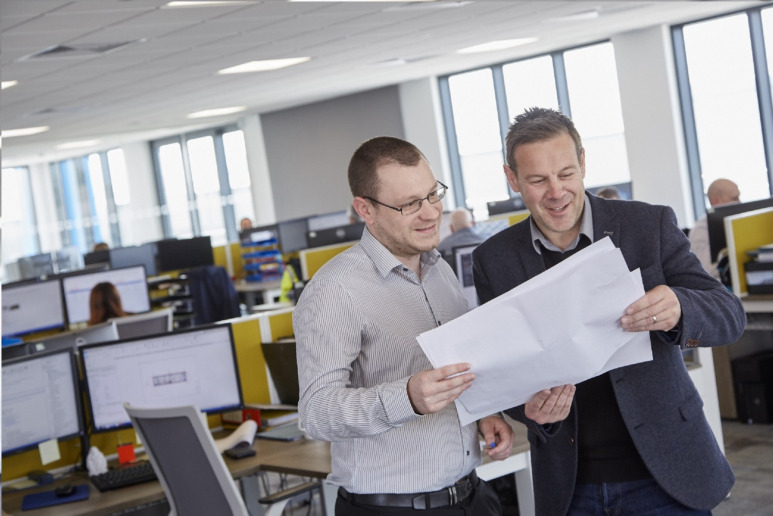 Design Technician Tom Graham, left, and Technical Director Mike Marriott review plans for one of Integra Buildings' latest bespoke modular buildings projects.