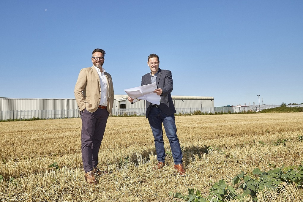 Integra Buildings Managing Director Gary Parker, left, and Technical Director Mike Marriott on the land adjoining the company's site which is earmarked for a new production facility as well as storage, loading and dispatch areas (Photo R&R Studio)