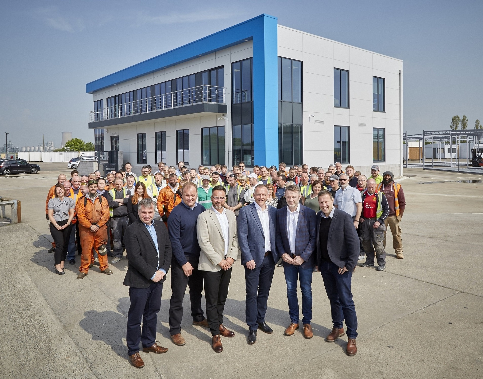 The Integra leadership team and staff in front of the company's self-built modular offices.