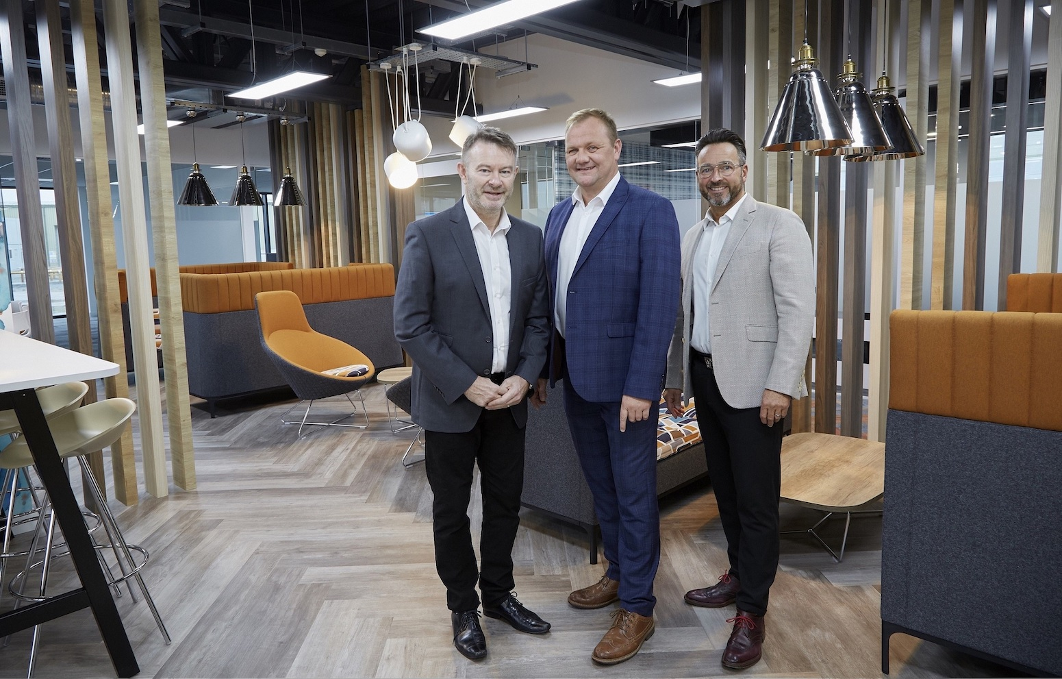 From right, Managing Director Gary Parker, Site and Health and Safety Director Paul Tansey and Finance Director John Drescher in the business lounge within Integra Buildings' showpiece new offices.