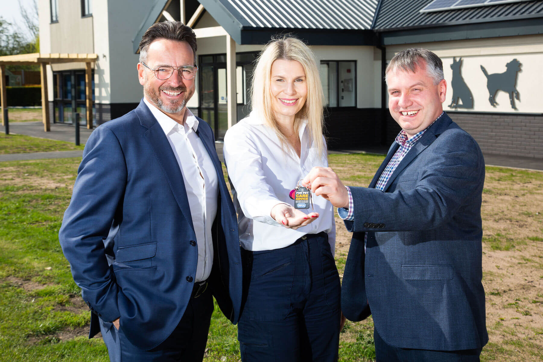 Integra Buildings Commercial Director Chris Turner hands over the keys to the new RSPCA Radcliffe rehoming and education centre to Centre Manager Ella Carpenter with Integra Managing Director Gary Parker.