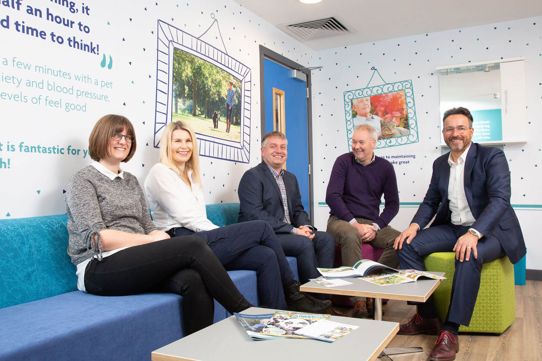Relaxing in the adoption lounge at the new RSPCA Radcliffe building are, from left, Rachel Jenkins, of Williams Architects, Centre Manager Ella Carpenter, Chris Turner of Integra Buildings, Clive Williams of Williams Architects, and Integra's Gary Parker.