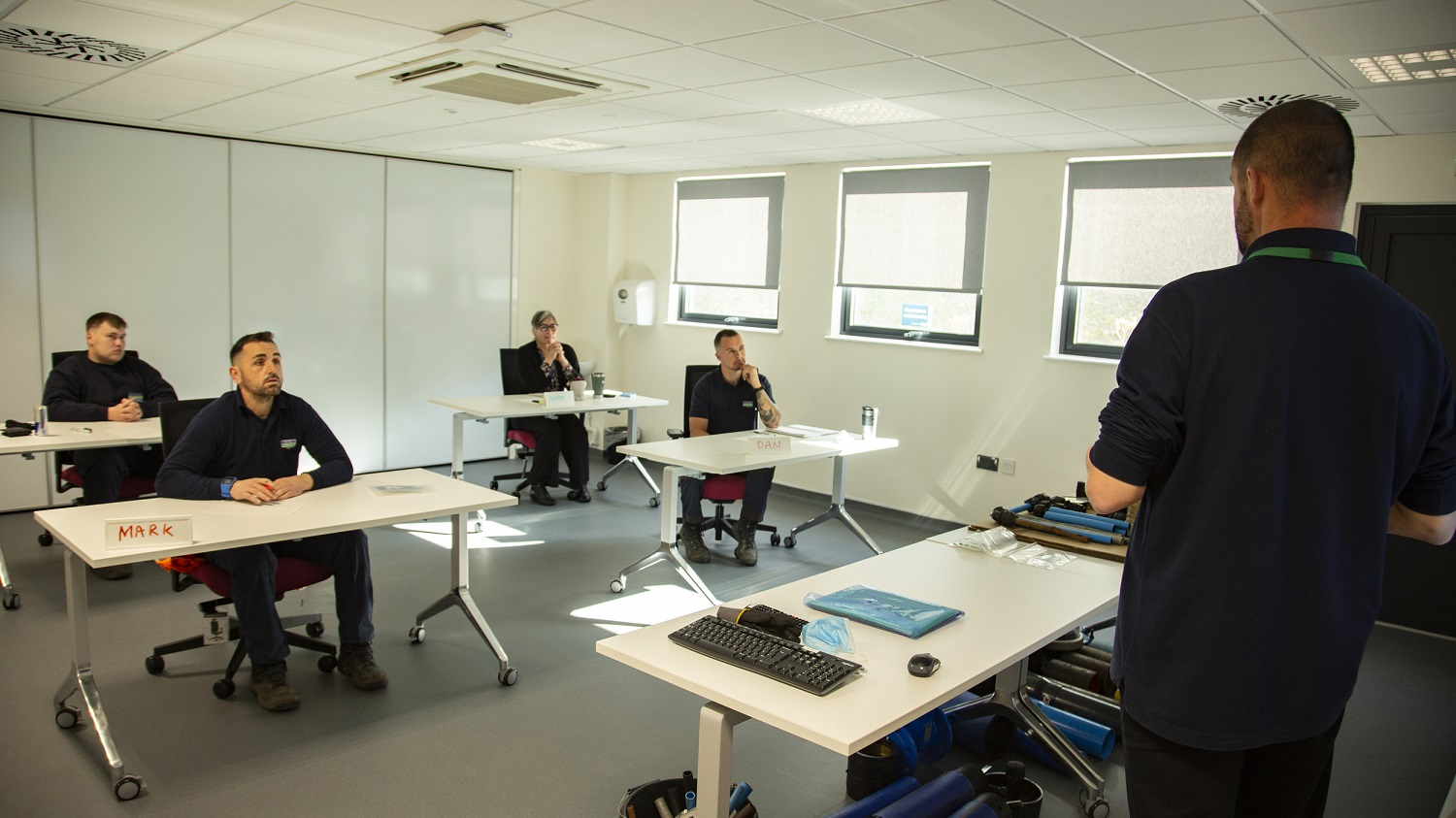 The academy combines traditional classroom-based learning with experimental training environments.