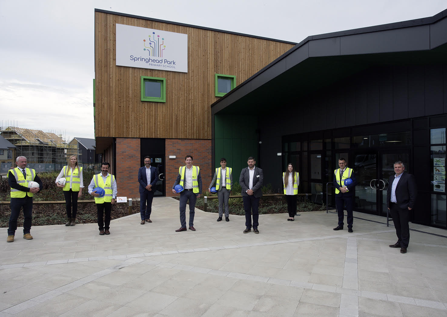 Integra Buildings Managing Director Gary Parker, fourth from left, and Commercial Director Chris Turner, right, at the grand opening of Springhead Park Primary School. Picture: Kier Construction/Carlos Dominguez Photography