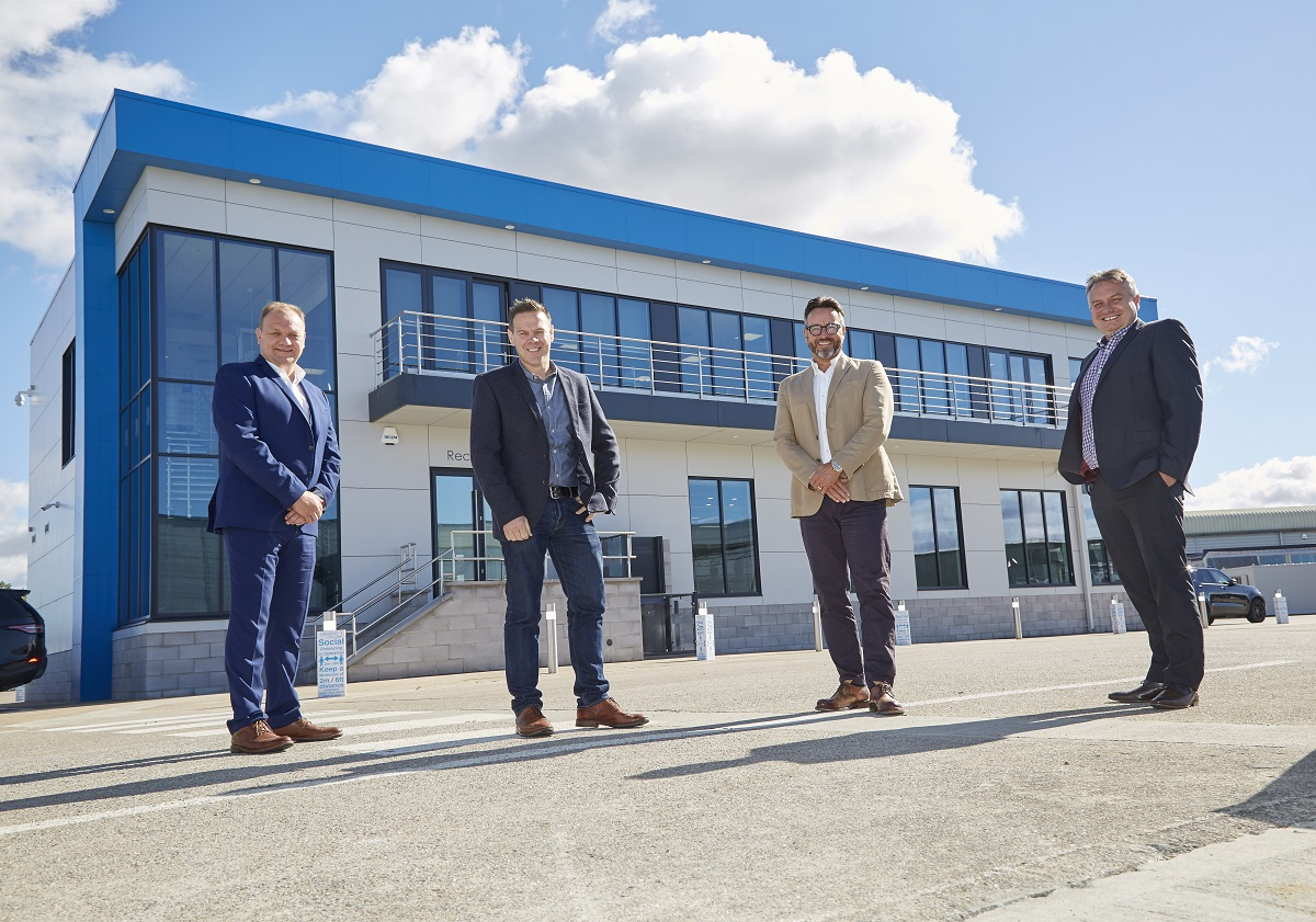 Integra Buildings Managing Director Gary Parker, second right, with fellow Directors, from left, Paul Tansey, Mike Marriott and Chris Turner, outside the company's self-built offices in Paull, East Yorkshire.